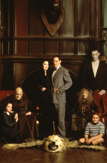Nov 10, 2000; Hollywood, California, USA; (L to R) Actors CHRISTINA RICCI (Wednesday Addams), CHRISTOPHER LLOYD (Fester Addams), ANJELICA HUSTON (Morticia Addams), RAUL JULIA (Gomez Addams), JUDITH MALINA (Granny Addams), CAREL STRUYCKEN (Lurch), and JIMMY WORKMAN (Pugsley Addams) in Orion Pictures' 'The Addams Family'. Mandatory Credit: Photo by Annie Leibovitz/Orion Pictures/ZUMA Press. (©) Copyright 2000 by Courtesy of Orion Pictures, HANDOUT
